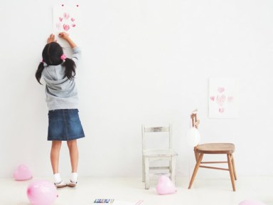 photo-of-little-girl-drawing-heart-shapes-98572