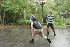 My son-in-law and sons playing basketball in the rain.